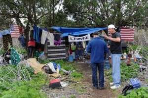 """At one of many """"cleanups"""" of the Santa Clara river bottom in Ventura (this one took place in February, 2011), a city official tries to persuade a homeless man to leave his camp. http://www.vcstar.com/news/2011/mar/01/ventura-clears-out-illegal-homeless-camps-in/"""